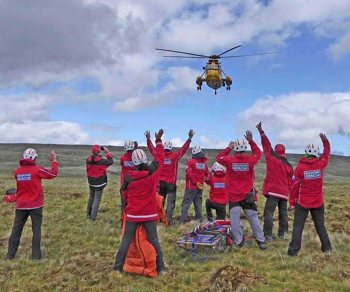 Kirkby Stephen Mountain Rescue waiting for a helicopter.