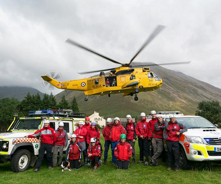 Wasdale Mountain Rescue group shot with vehicles and helicopter.